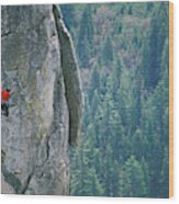 Man Climbing On A Big Granite Spire Wood Print