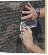 Man Getting A Rubbing Of Fallen Soldier's Name At The Vietnam War Memorial Wood Print