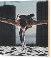 Man Holding Yoga Pose In The Sand Wood Print
