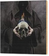 Man In The Hooded Cloak Holding Burning Human Skull In His Hand Wood Print
