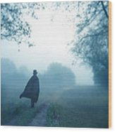 Man In Top Hat And Cape On Foggy Dirt Road Wood Print