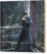 Man In Trenchcoat Lighting A Cigarette Wood Print