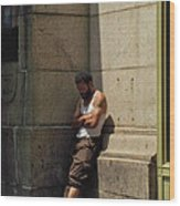 Man Leaning Against Wall In Sun Wood Print