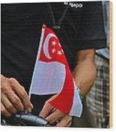 Man Plants Singapore Flag On Bicycle Wood Print