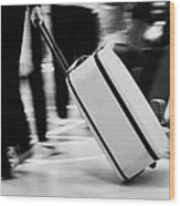 man pulling red wheeled luggage out of Reina Sofia Sur TFS South Airport Tenerife Canary Islands Spain Wood Print