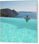 Man Relaxing Looking At Santorini Wood Print