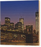 Manhattan By Night Wood Print by Melanie Viola