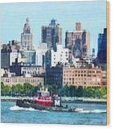 Manhattan - Tugboat Against Manhattan Skyline Wood Print