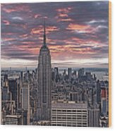 Manhattan Under A Red Sky Wood Print by Joachim G Pinkawa