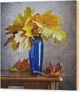 Maple Leaves In Blue Vase  Wood Print