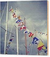 Marine Signal Flags On Mast Against A Wood Print