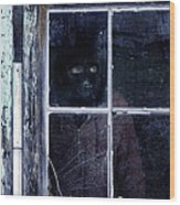 Masked Man Looking Out Window Wood Print
