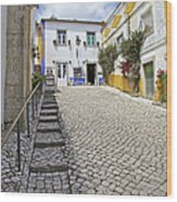 Medieval Cobblestone Street In The Fortified Walled European Village Of Obidos Wood Print