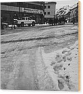 melting ice and snow on street surface holmen Honningsvag finnmark norway europe Wood Print
