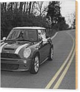 Mini-cooper Car Driving On Double Yellow Country Road Wood Print