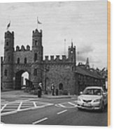 modern traffic driving past Entrance to Macroom Castle County Cork Ireland Wood Print