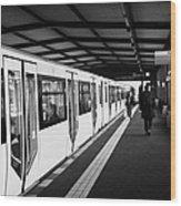 modern yellow u-bahn train sitting at station platform Berlin Germany Wood Print