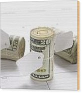 Money Rolls On Calendar Wood Print by Joe Belanger