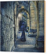 Monk In A Dark Corridor Wood Print