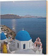 Moon Over Blue Domed Church In Oia Santorini Greece Wood Print by Matteo Colombo