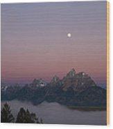Moon Setting Over Tetons At Dawn Wood Print