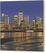 Moonrise Over River Thames Flowing Past Canary Wharf Wood Print