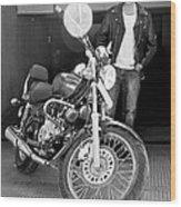 Motorbiker Looks On Dotingly Wood Print