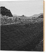 mound of Turf peat cut next to the cut seam in a peat bog in Connemara Wood Print