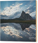 Mountain Peak And Clouds Reflected In Alpine Lake In The Dolomit Wood Print