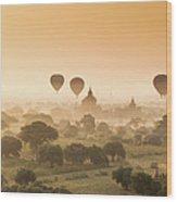 Myanmar Burma - Balloons Flying Over Wood Print