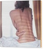 Naked Back Of A Woman Sitting On A Bed Wood Print