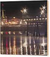 Night On Santa Monica Beach Pier With Bright Colorful Lights Reflecting On The Ocean And Sand Fine A Wood Print