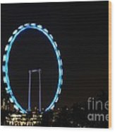 Night Shot Of The Singapore Flyer Ferris Wheel At Marina Bay Wood Print