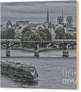 Notre Dame And Boat On The River Seine Paris Wood Print