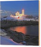 Nubble Lighthouse Holiday Lights And Winter Moon Wood Print by John Burk