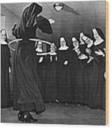Nun Swivels Hula Hoop On Hips Wood Print
