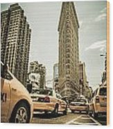 Nyc Yellow Cabs At The Flat Iron Building - V1 Wood Print by Hannes Cmarits