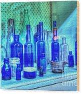 Old Blue Bottles Wood Print