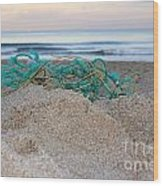 Old Fishing Net On Beach Wood Print
