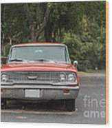 Old Ford Galaxy In The Rain Wood Print