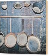 Old Kitchen Utensils On Soot-black Wall Wood Print