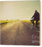 Old Man Riding A Bike To Sunny Sunset Sky Wood Print