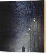 Old Man Walking On Snowy Winter Path At Night Wood Print by Sandra Cunningham