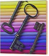 Old Skeleton Keys On Rows Of Colored Pencils Wood Print
