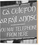 Old Style Weathered You May Telephone From Here Green And Gold Sign In Irish And English In Dublin Wood Print