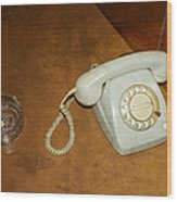 Old Telephone And Ashtray On Brown Table Wood Print by Matthias Hauser