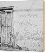 old weathered green painted wooden door entrance to abandoned house with cracked stucco walls and graffitti in Tacoronte Tenerife Canary Islands Spain Wood Print