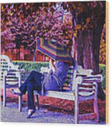 On A Bench Under An Umbrella In Autumn Wood Print