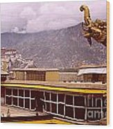On Jokhang Monastery Rooftop Wood Print by Anna Lisa Yoder