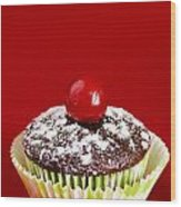 One Chocolate Cupcake With Cherry Over Red Wood Print